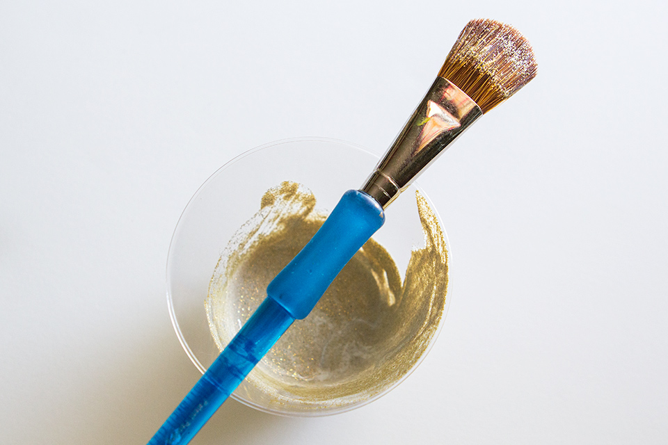 Mix equal parts fine glitter and mod podge to create a glittered paint that doesn't rub off.