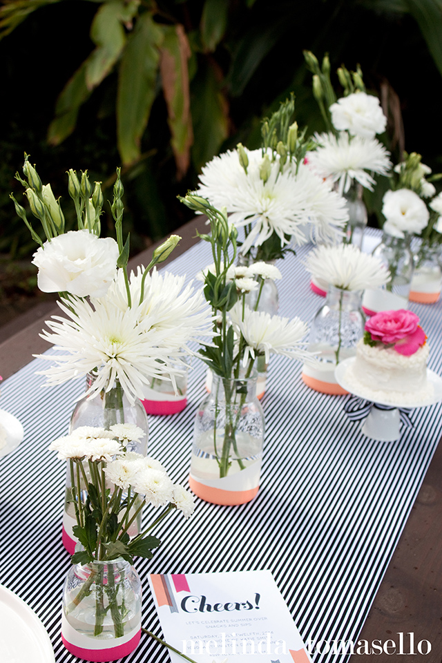 Black and white stripes with a pop of bright pink and sherbet orange make for a fun summer party.