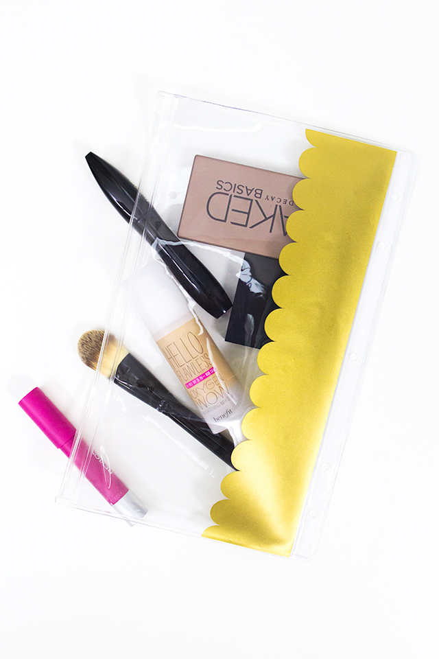 Pencil cases aren't just for school supplies. Grab a cheap pencil pouch and add some gold adhesive vinyl for a chic makeup bag.