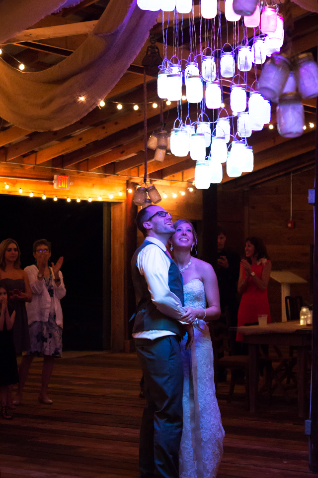 This groom constructed a chandelier out of Ball mason jars. Each jar was controlled as a separate pixel, changed colors and lit up in rhythm to the song of their first dance. So cool!