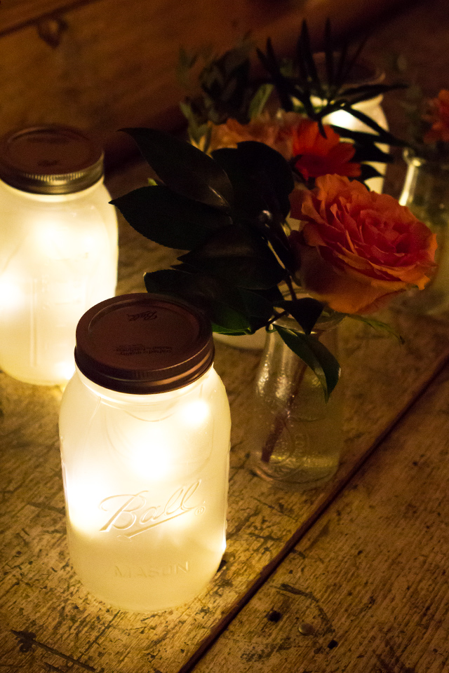 Love these DIY frosted mason jars filled with white LED lights. Simple but pretty way to add light to a reception space.