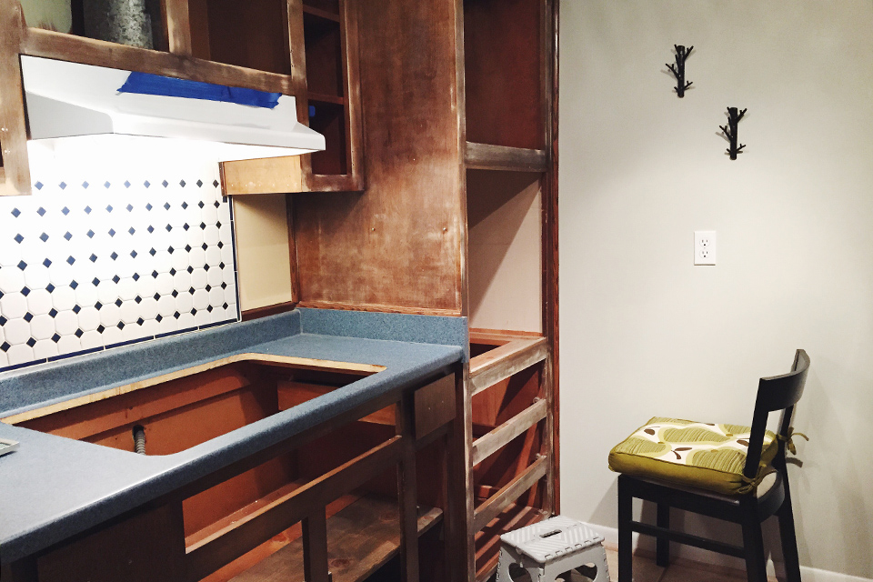 This post goes over everything you need to refinish and paint your kitchen cabinets yourself.