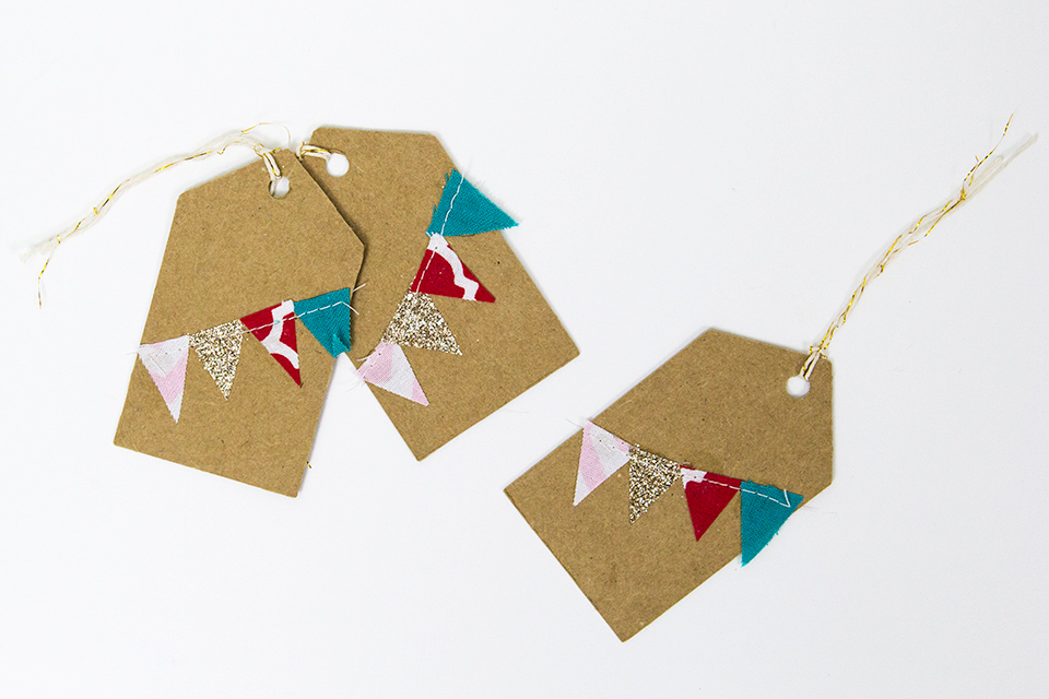 Make your holiday gifts extra special with these hand sewn gift tags from Lima Green Designs.