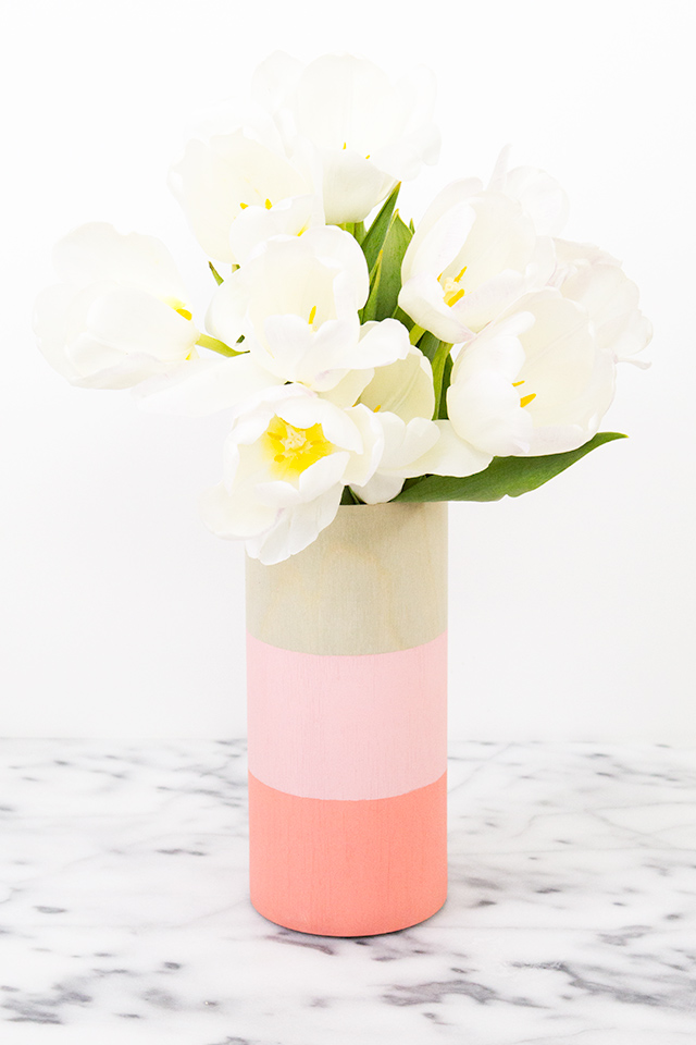 Dress up a plain glass vase using adhesive wood veneer. Click through for tutorial and tips.