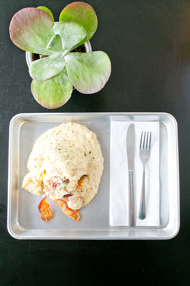 Next time you're visiting Orlando checkout Se7enbites, a sweet and savory bakeshop. The Southern is one of their most popular dishes: a biscuit topped with a baked egg, bacon, pimento cheese, and cheese grits. Cheat day worthy!