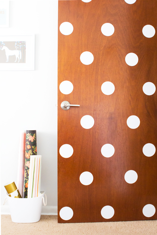 Add vinyl polka dots to a door for a fun and playful look. Cute for a kid's room or even an office.