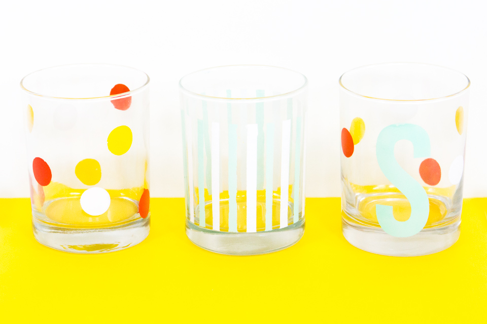 These bright and cheerful glasses were created using stencils cut with a Silhouette Cameo. Such a fun way to create personalized drinking glasses!