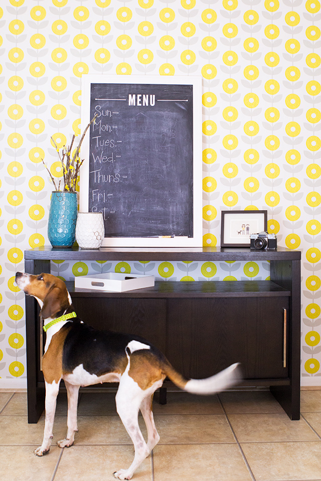 Love the idea of wallpapering one wall in a dining room or living area to create a statement wall. This wallpaper is completely removable; all you have to do is peel and stick it!