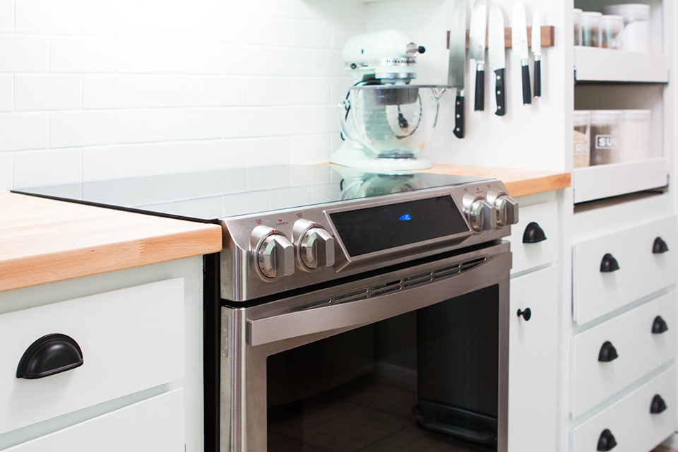 Love this Samsung Chef Collection range. It works so well with subway tile and butcher block countertops.
