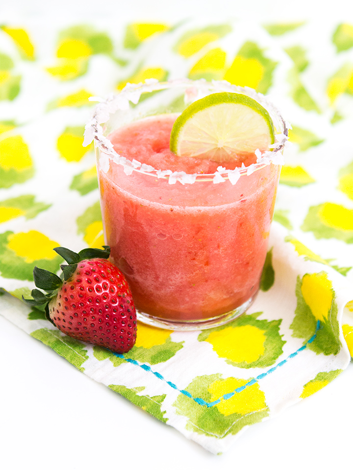 Love strawberry margaritas? Try this icy frozen version that uses Natalie's freshly squeezed citrus margarita mix.