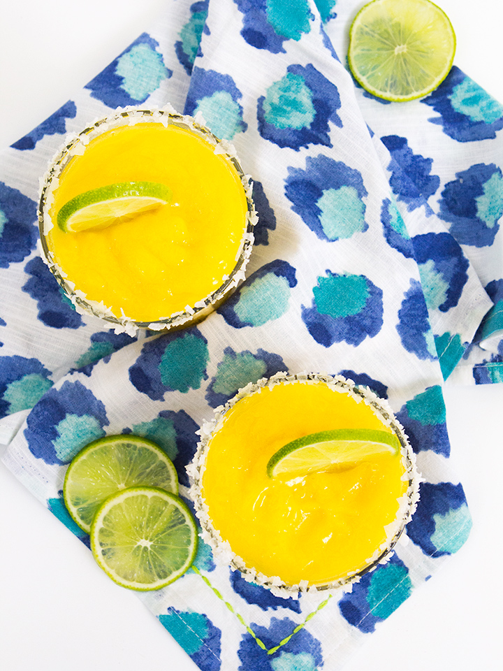 Even if you're not a big fan of margaritas you're sure to love this delicious mango frozen version. It's made with Natalie's fresh margarita mix and blended with frozen mangos.