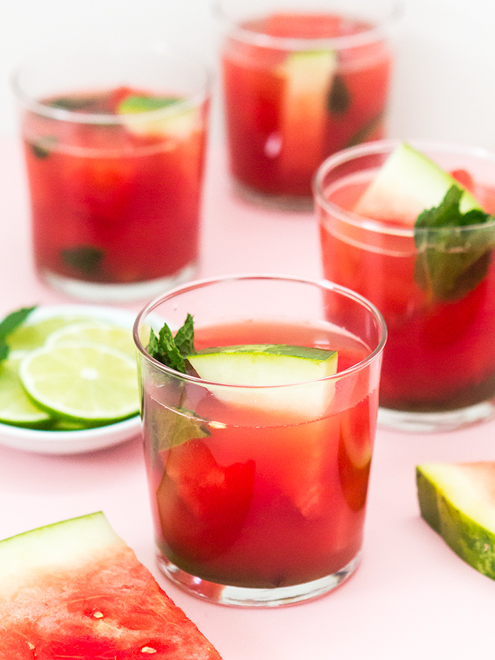 Nothing says summer quite like a refreshing cocktail made with juicy watermelon! Try this crowd pleasing punch recipe that's perfect for Memorial Day and summer parties. (Click through for the recipe to make watermelon mint aqua fresca punch)