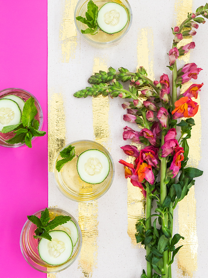 Learn how to make this pretty gold foil table runner and these even prettier elderflower cocktails in this tutorial!
