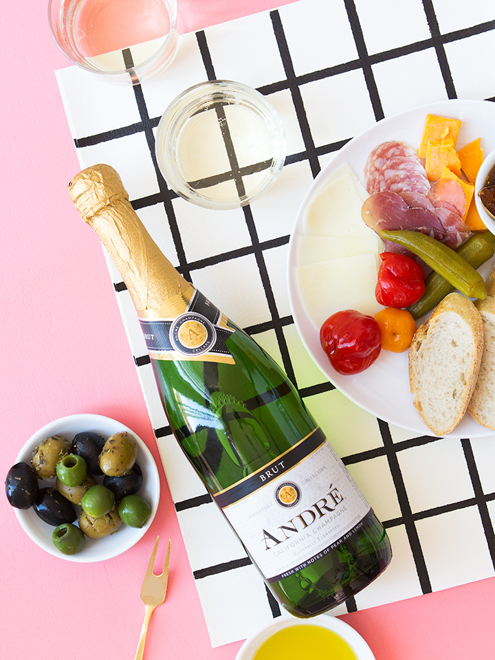 DIY grid placemats plus an antipasto platter and some bubbly make for an easy (and stylish) entertaining solution!