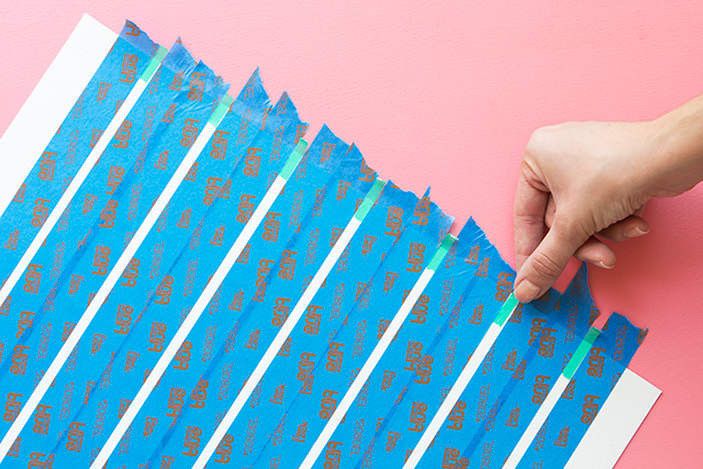 Apply thin washi tape and painters tape to create an easy to paint grid pattern.