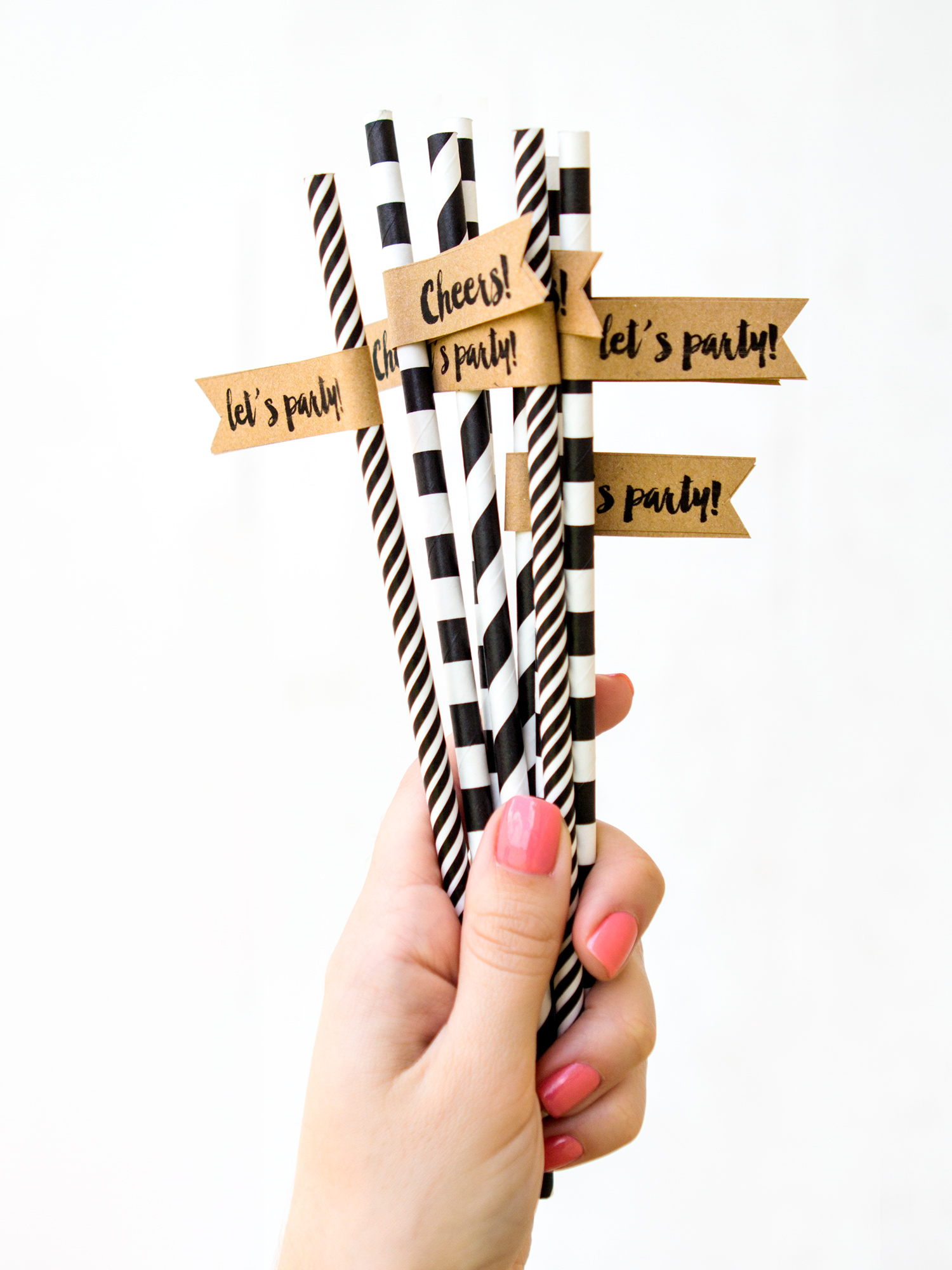 Create custom straws for your wedding, birth party, shower or any occasion! Click through to download the free template and watch the video tutorial on how to assemble them.