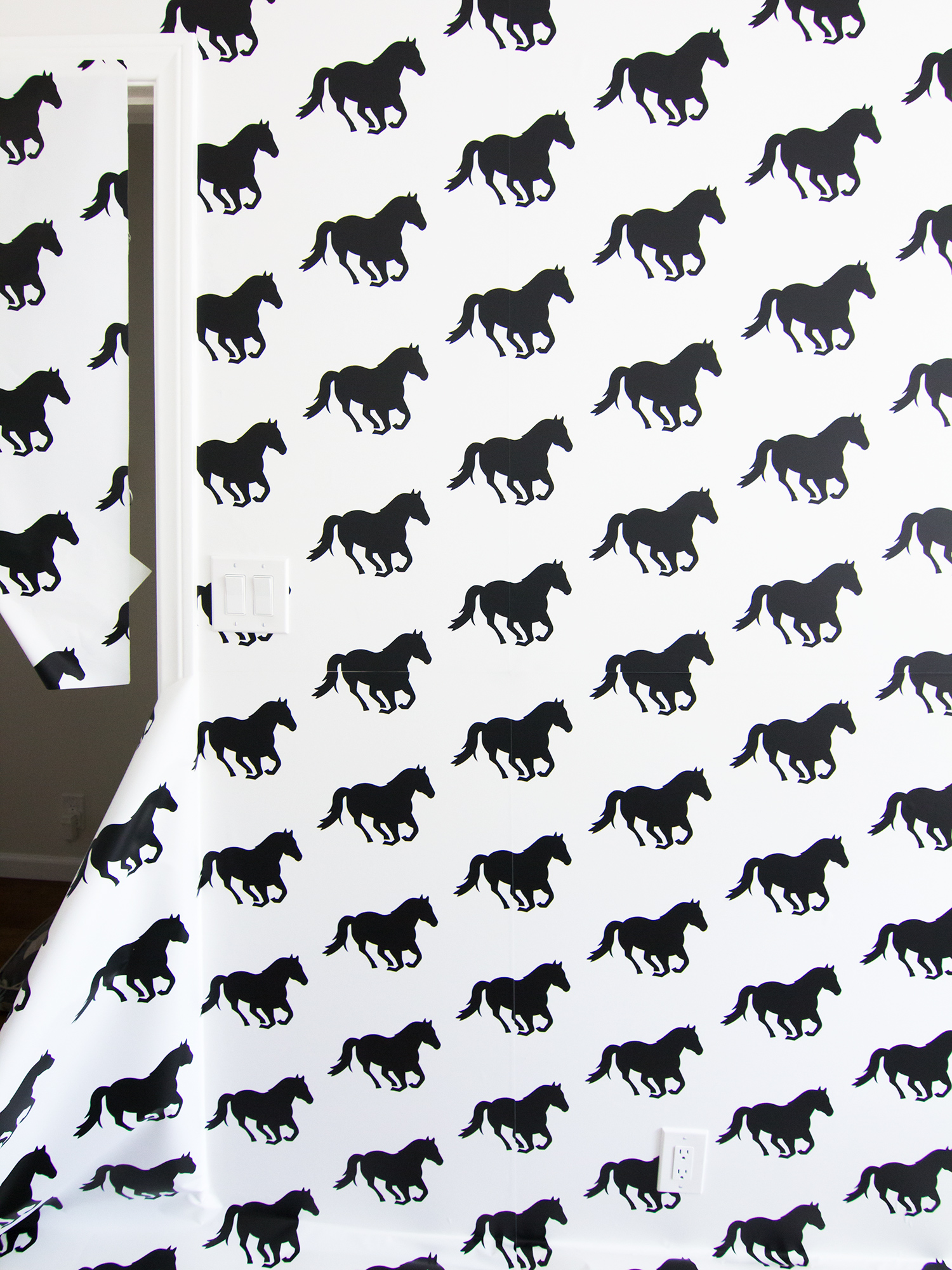 See how blogger Sarah Hearts gave her office a temporary update with a horse  print peel