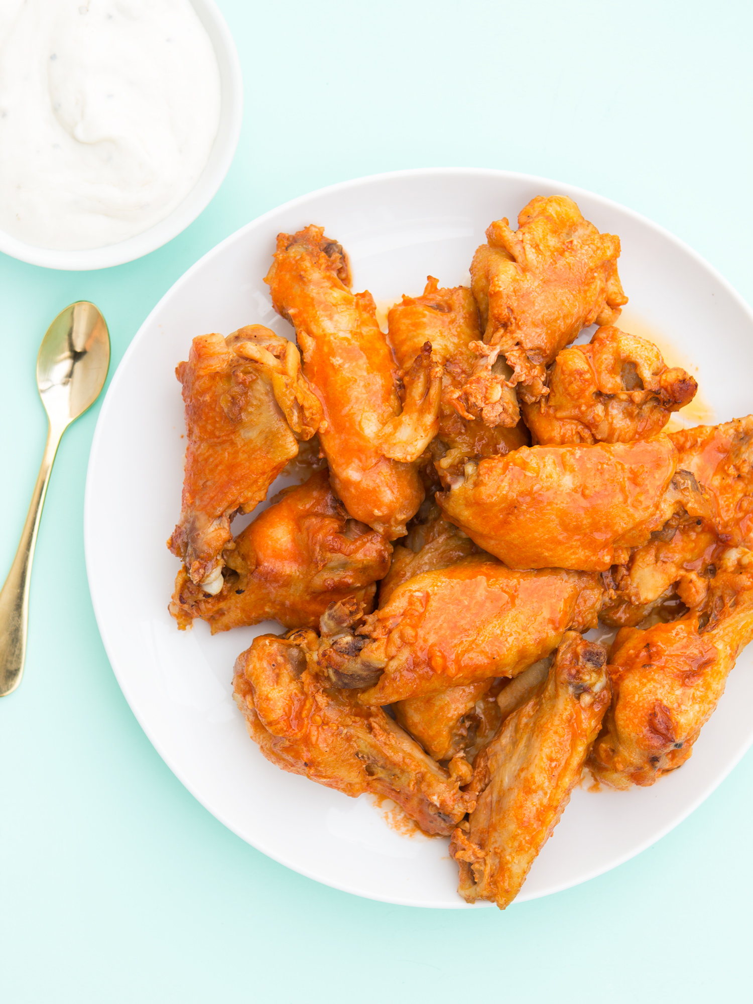 You're going to want to try these crispy oven baked chicken wings with homemade buffalo sauce. They are the perfect party food! You'll want to try the other 2 variations too!
