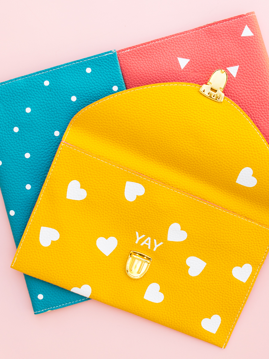 Create an adorable customized heart, dot, or triangle patterned clutch purse in minutes using a Silhouette Cameo, Portrait, or Curio. (Click through for free Silhouette Studio cut file and tutorial)