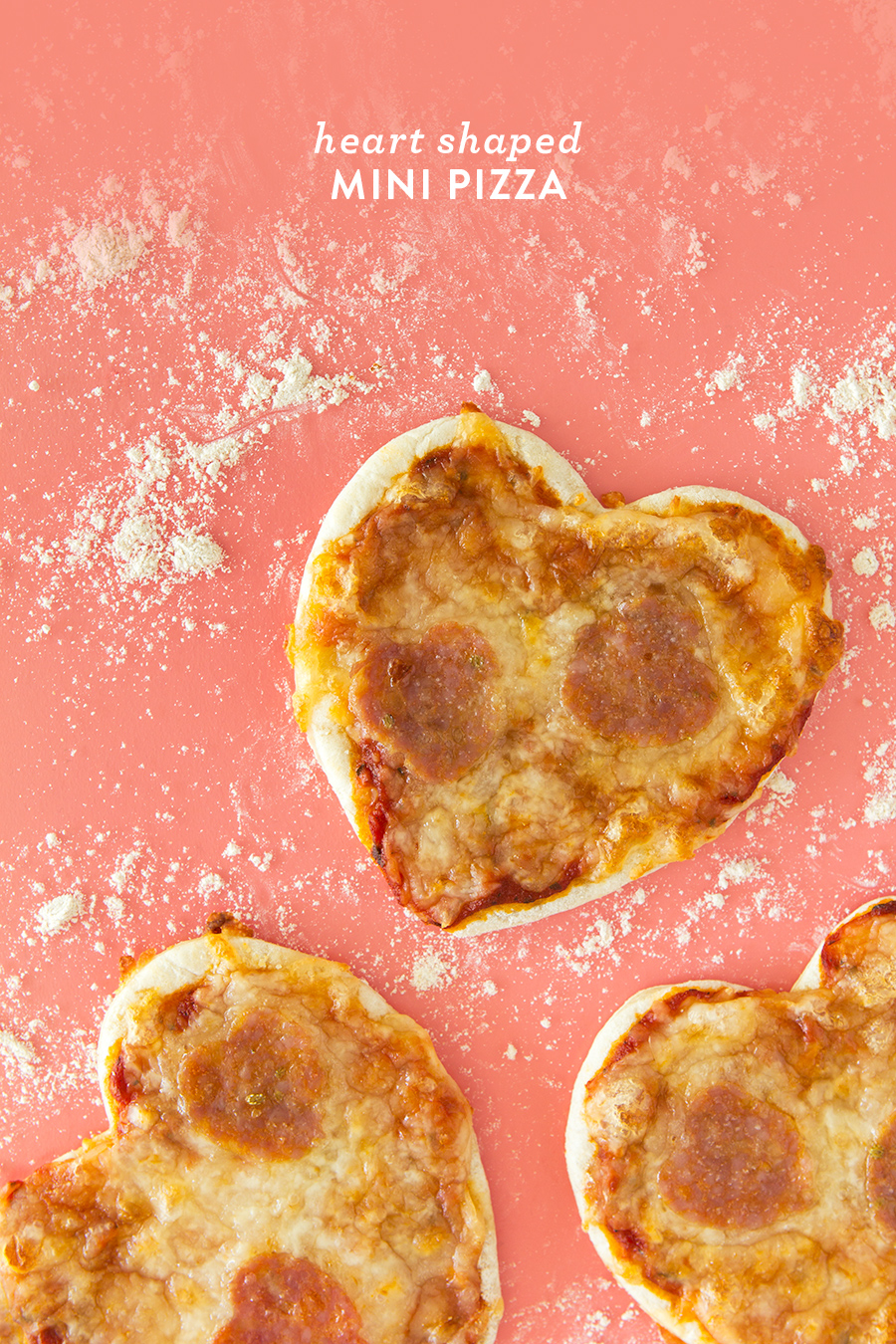 Homemade mini heart pizzas are so easy to make! Perfect for valentines, pizza lovers, or occasion! (Click through for recipe video)
