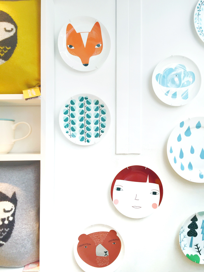 Hanging plates on a wall for instant wall art in Smug, a boutique in London