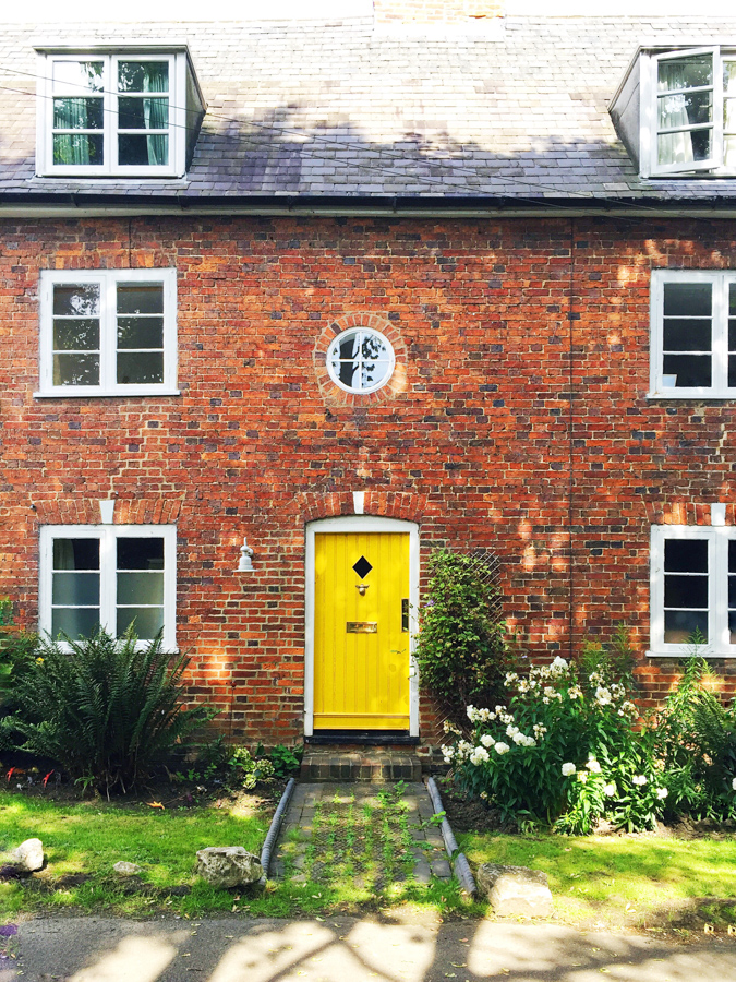 Bright and cheery yellow front door spotted on a home in Foxton, Leicestershire England
