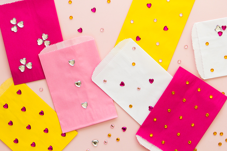 Dress up plain paper treat bags using jewels and glue dots. Perfect for party favors, small gifts and more!