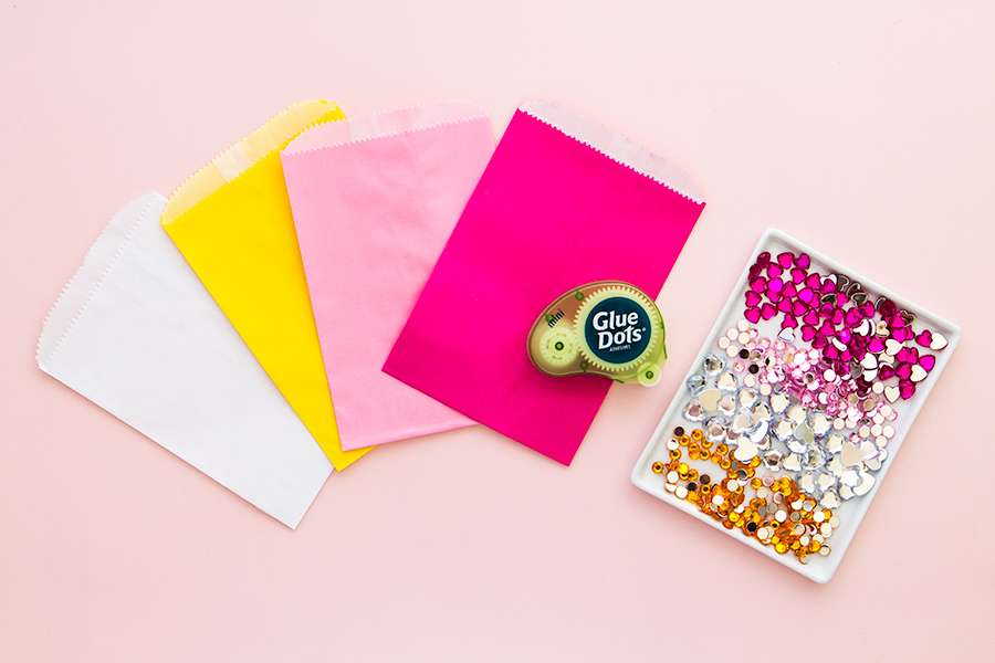 Use jewels in your favorite colors and shapes to decorate treat bags.