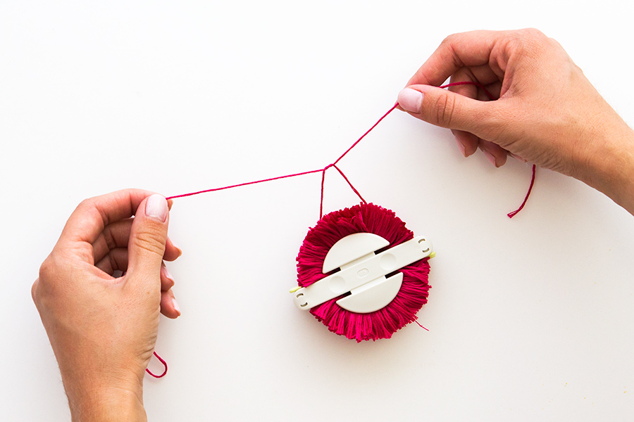 Pom poms made easy! Learn how to use a pom pom maker in this easy to follow tutorial.