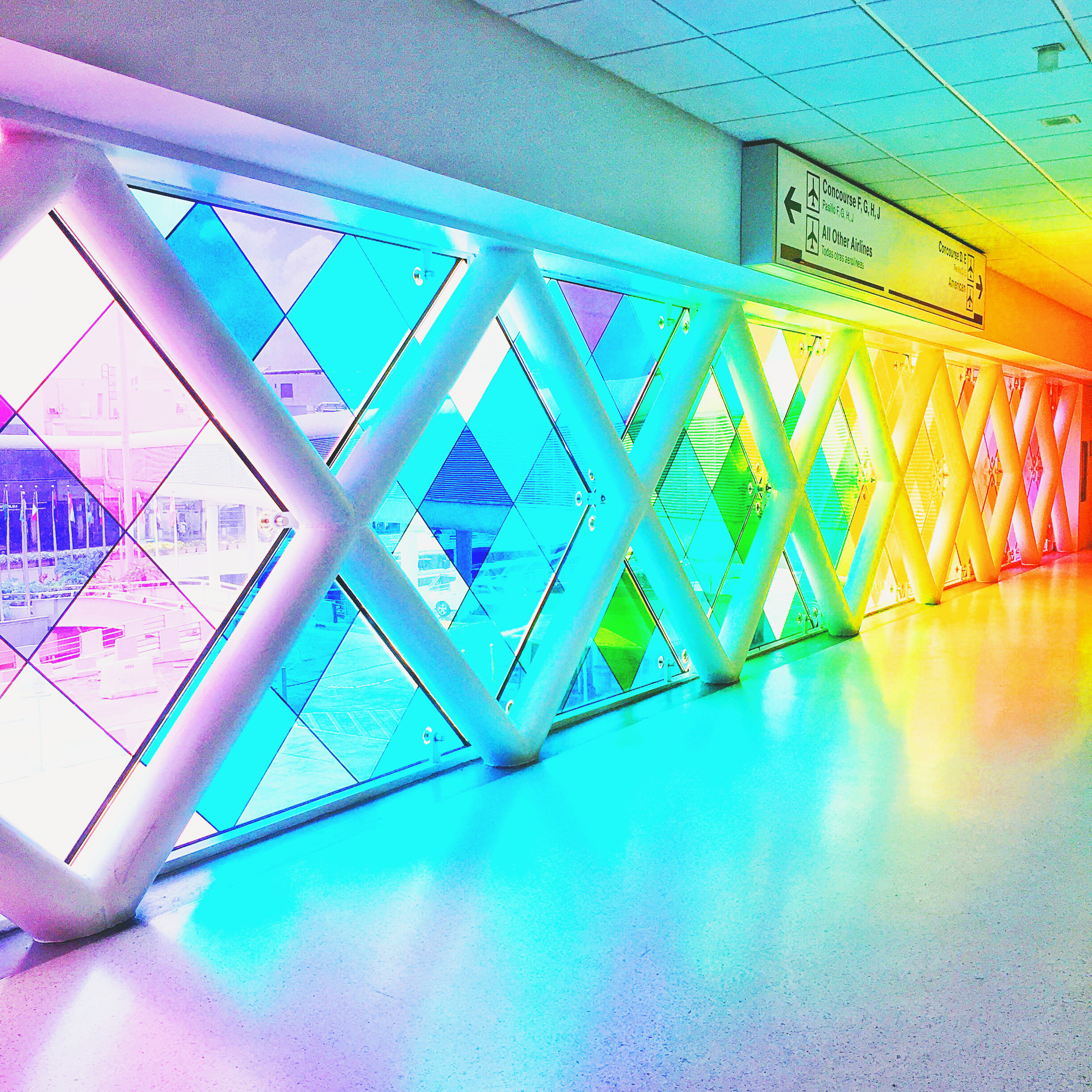 The colorful glass walkway at the Miami International Airport rental car center is a must see!
