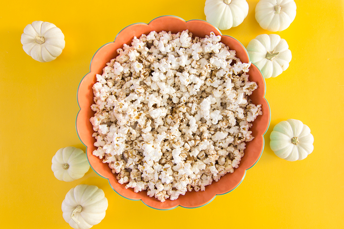 If you love pumpkin spice lattes then you'll love this sweet and savory snack! This pumpkin spice popcorn recipe only takes 5 minutes to make!