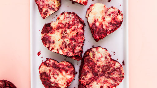 Start with a cake mix to make these easy, cheesecake topped red velvet brownies. So perfect for Valentines Day!