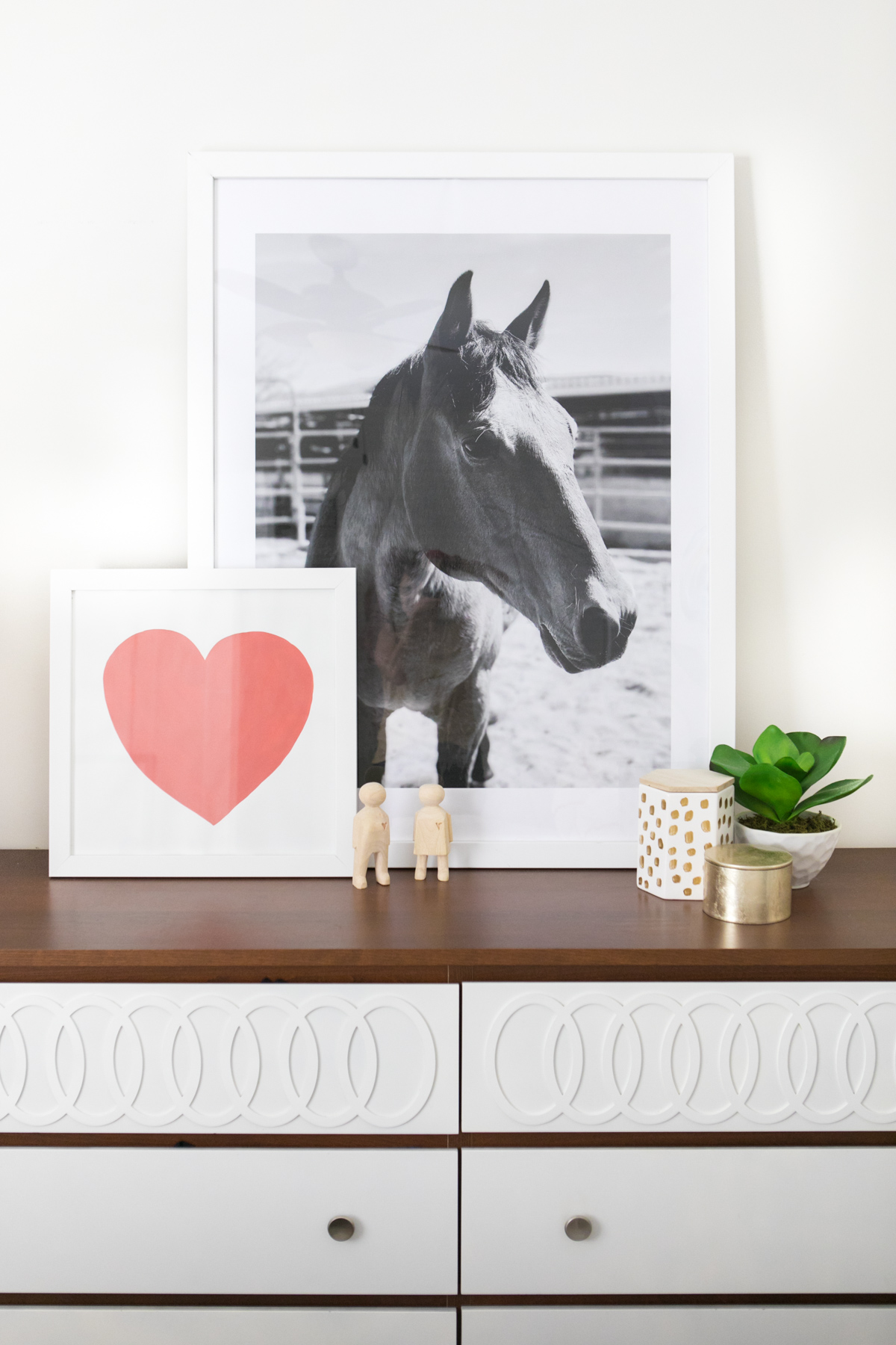 Use @devinecolor paint to paint a large heart on poster board. Get photos printed as engineer prints for cheap, large art.