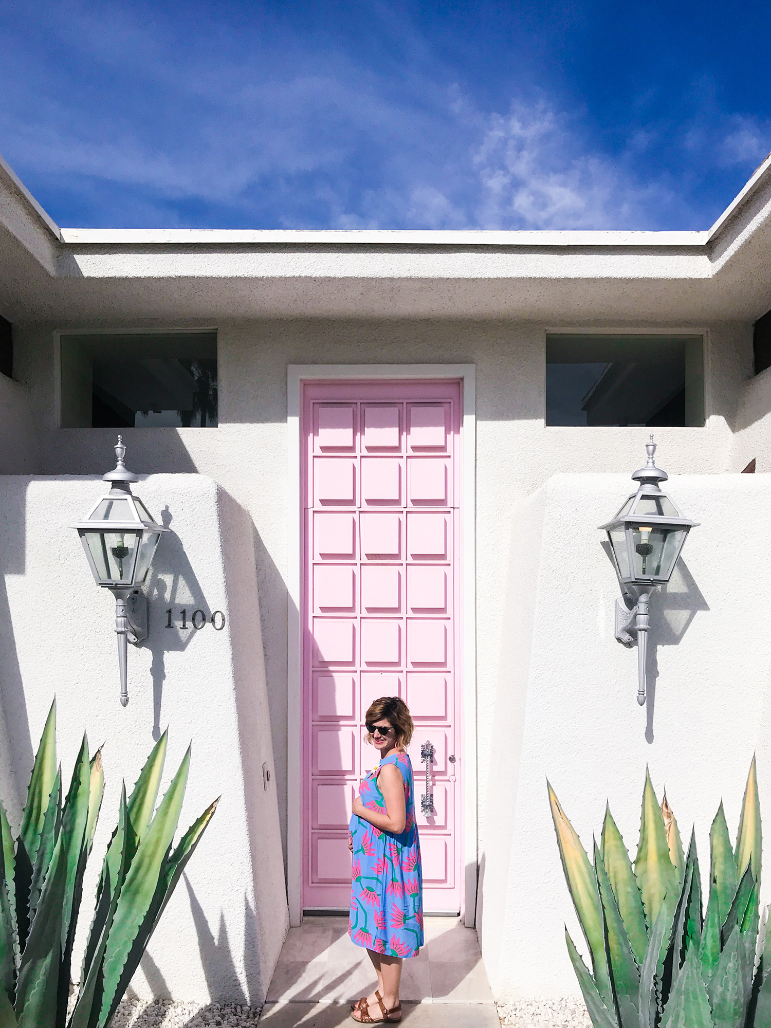 Photo of the famous pink door in Palm Springs with blogger Sarah Khandjian